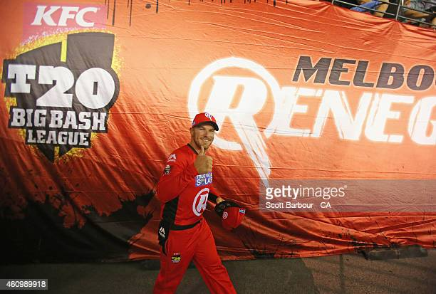 Aaron Finch captain of the Renegades gestures as he leads his team out onto the field during the Big Bash League match between the Melbourne...