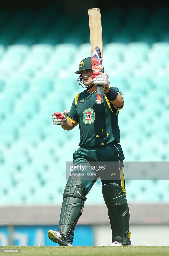 <a gi-track='captionPersonalityLinkClicked' href=/galleries/search?phrase=Aaron+Finch+-+Cricket+Player&family=editorial&specificpeople=724040 ng-click='$event.stopPropagation()'>Aaron Finch</a> of Australia 'A' celebrates scoring his century during the International Tour match between Australia 'A' and the England Lions at Sydney Cricket Ground on February 25, 2013 in Sydney, Australia.