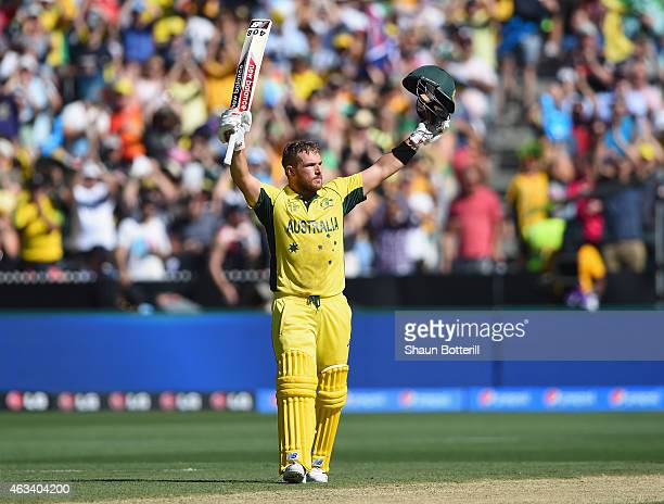 Aaron Finch of Australia celebrates after reaching his century during the 2015 ICC Cricket World Cup match between England and Australia at Melbourne...
