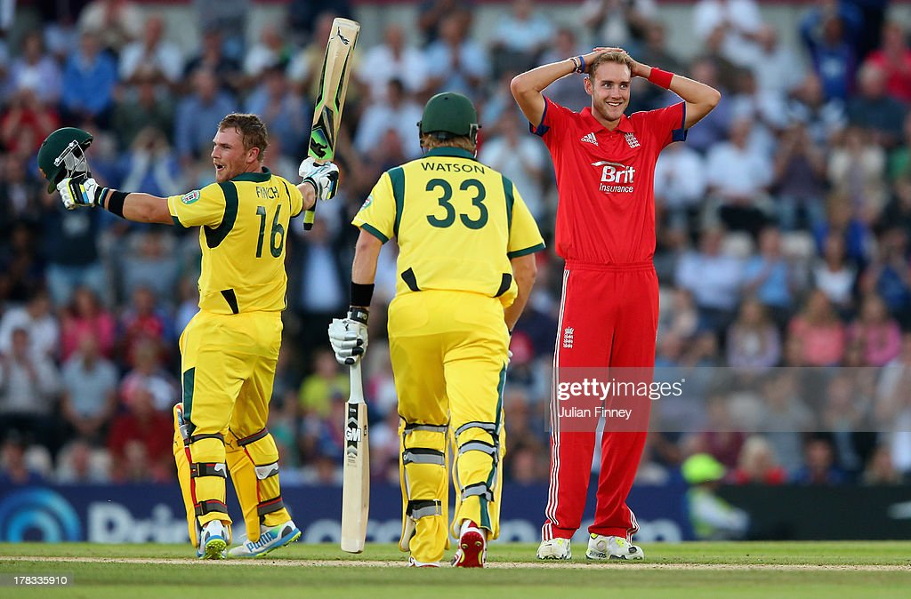 <a gi-track='captionPersonalityLinkClicked' href=/galleries/search?phrase=Aaron+Finch+-+Cricket+Player&family=editorial&specificpeople=724040 ng-click='$event.stopPropagation()'>Aaron Finch</a> of Australia celebrates his century as <a gi-track='captionPersonalityLinkClicked' href=/galleries/search?phrase=Stuart+Broad&family=editorial&specificpeople=574360 ng-click='$event.stopPropagation()'>Stuart Broad</a> of England looks on during the 1st NatWest Series T20 match between England and Australia at Ageas Bowl on August 29, 2013 in Southampton, England.