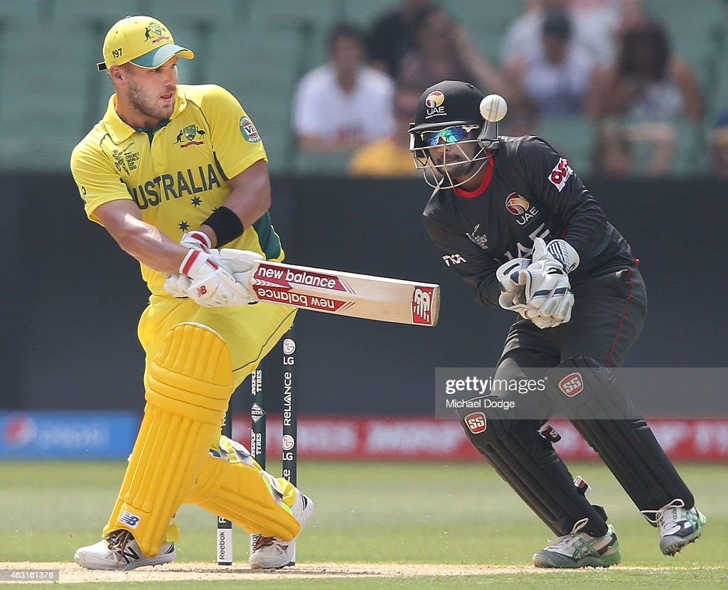 <a gi-track='captionPersonalityLinkClicked' href=/galleries/search?phrase=Aaron+Finch+-+Cricket+Player&family=editorial&specificpeople=724040 ng-click='$event.stopPropagation()'>Aaron Finch</a> of Australia hits the ball past wicket keeper Swapnil Patil of UAE during the Cricket World Cup warm up match between Australia and the United Arab Emirates at Melbourne Cricket Ground on February 11, 2015 in Melbourne, Australia.