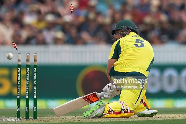 Aaron Finch of Australia is bowled out by Mitchell Santner of New Zealand during game two of the One Day International series between Australia and...