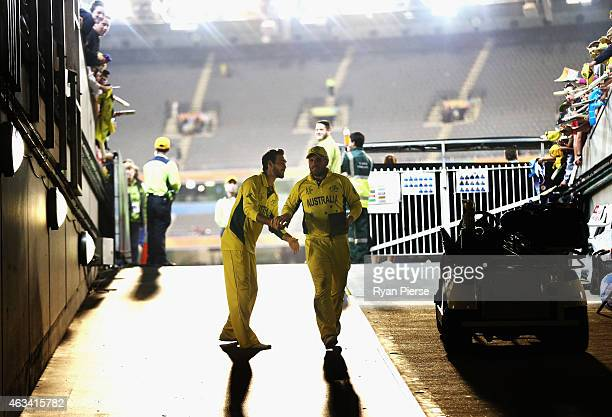 Aaron Finch of Australia is congratulated by Glenn Maxwell of Australia after collecting his player of the match award during the 2015 ICC Cricket...