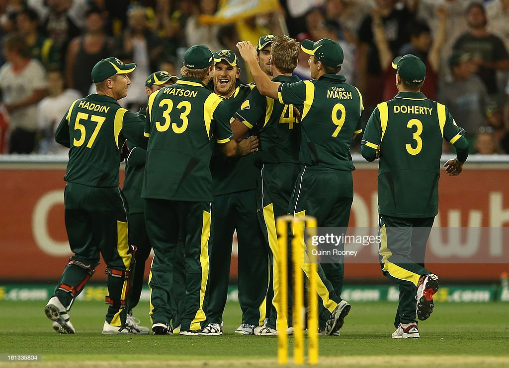 Aaron Finch of Australia is congratulated by team mates after taking a catch to get the wicket of Keiron Pollard of the West Indies during game five of the Commonwealth Bank International Series between Australia and the West Indies at Melbourne Cricket Ground on February 10, 2013 in Melbourne, Australia.