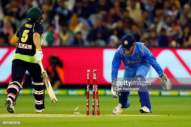 Aaron Finch of Australia is dismissed runout by Ravendrasinh Jadeja during the International Twenty20 match between Australia and India at Melbourne...