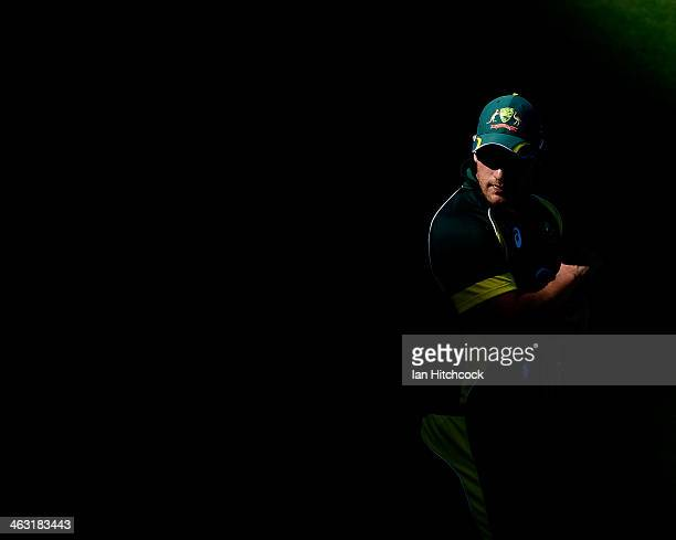 Aaron Finch of Australia looks on during the second game of the One Day International Series between Australia and England at The Gabba on January 17...