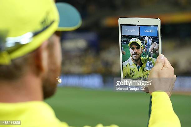 Aaron Finch of Australia taes a selfie with his mobile phone during the 2015 ICC Cricket World Cup match between England and Australia at Melbourne...
