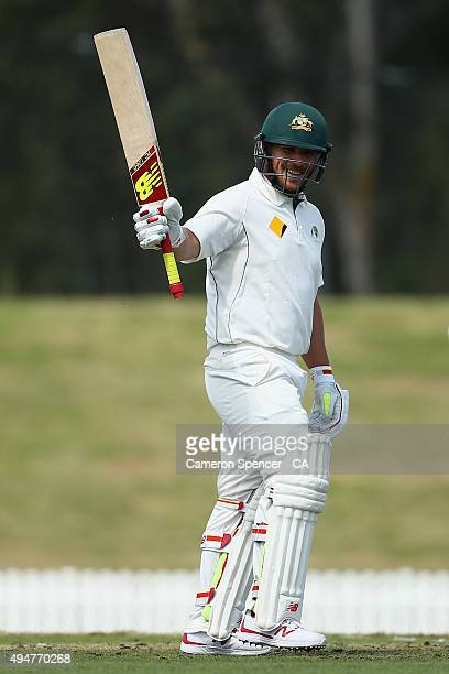 Aaron Finch of Cricket Australia XI celebrates scoring a century during the Tour Match between the Cricket Australia XI and New Zealand at Blacktown...