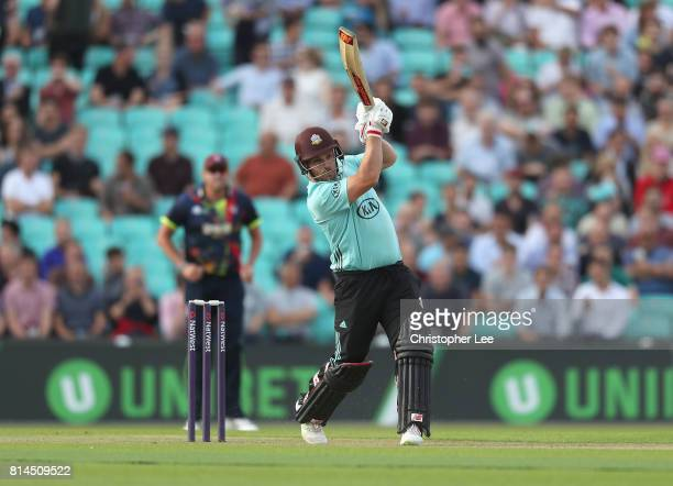 Aaron Finch of Surrey drives to the boundary during the NatWest T20 Blast match between Surrey and Kent at The Kia Oval on July 14 2017 in London...