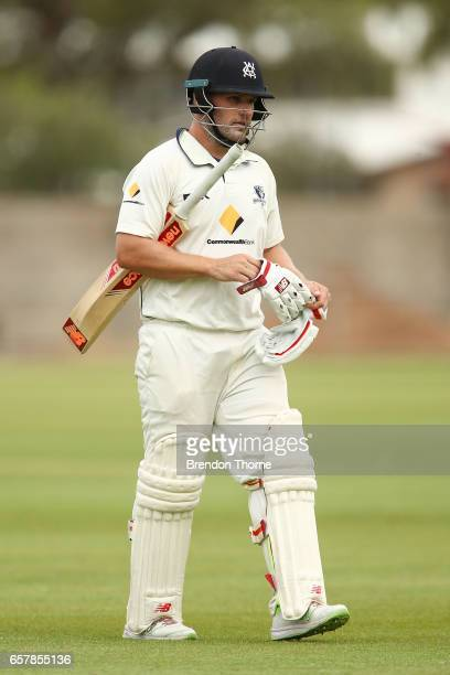 Aaron Finch of the Bushrangers walks back to the pavilion after being dismissed by Chadd Sayers of the Redbacks during the Sheffield Shield final...