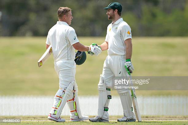 Aaron Finch of the CA XI shakes hands with Ryan Carters after scoring his double and a half century during the international tour match between the...