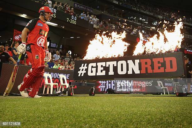Aaron Finch of the Melbourne Renegades walks out to bat during the Big Bash League match between the Melbourne Renegades and the Melbourne Stars at...