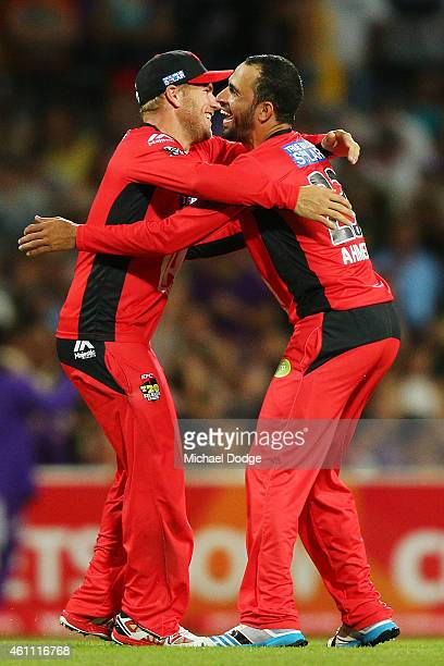 Aaron Finch of the Renegades hugs Fawad Ahmed who dismissed George Bailey of the Hurricanes during the Big Bash League match between the Hobart...