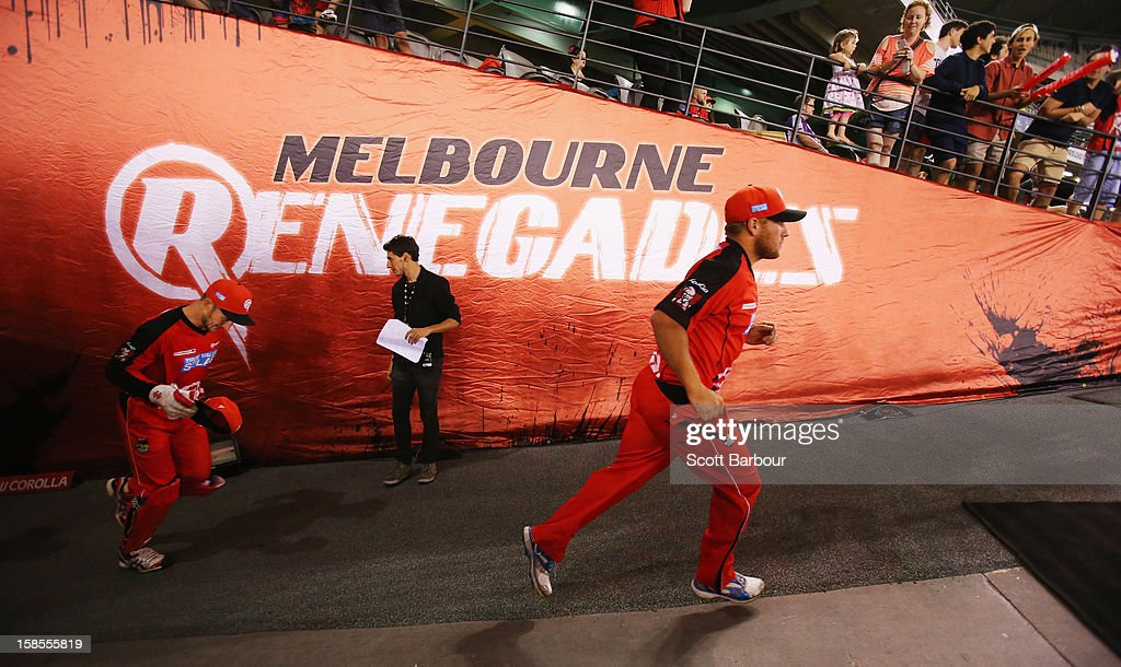 <a gi-track='captionPersonalityLinkClicked' href=/galleries/search?phrase=Aaron+Finch+-+Cricket+Player&family=editorial&specificpeople=724040 ng-click='$event.stopPropagation()'>Aaron Finch</a> of the Renegades leads his team onto the field during the Big Bash League match between the Melbourne Renegades and the Hobart Hurricanes at Etihad Stadium on December 19, 2012 in Melbourne, Australia.