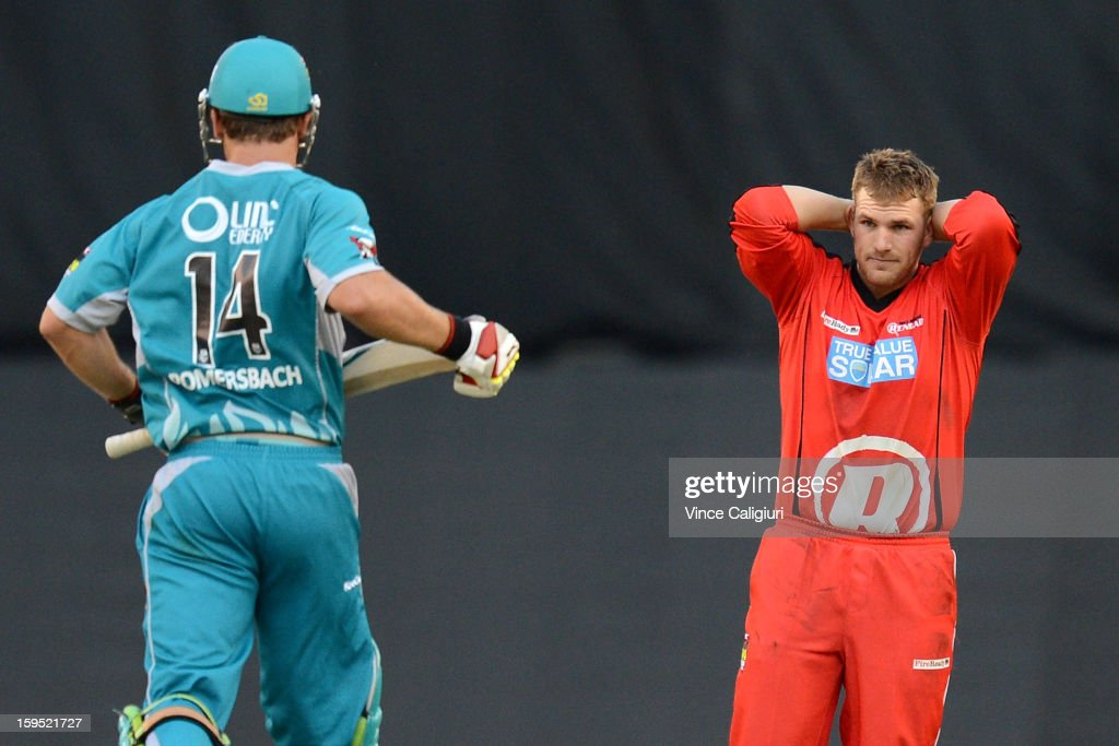 Aaron Finch of the Renegades puts his hands up in despair as Luke Pomersbach of the Heat hits more runs during his innings of 112 during the Big Bash League Semi-Final match between the Melbourne Renegades and the Brisbane Heat at Etihad Stadium on January 15, 2013 in Melbourne, Australia.