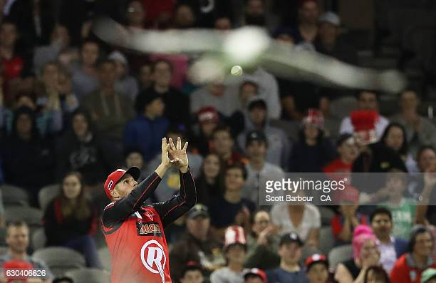 Aaron Finch of the Renegades takes a catch to dismiss Arjun Nair of the Thunder during the Big Bash League match between the Melbourne Renegades and...