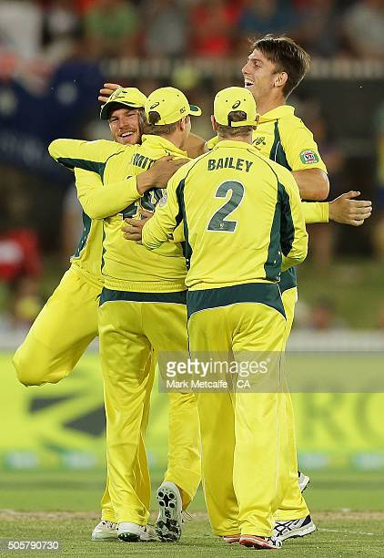 Aaron Finch Steve Smith George Bailey and Mitchell Marsh celebrate victory after the final wicket during the Victoria Bitter One Day International...