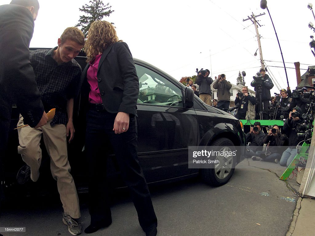 Aaron Fisher, known previously simply as 'Victim 1' gets out of a car as he enters the Centre County Courthouse before former Penn State assistant football coach Jerry Sandusky (not pictured) is sentenced in his child sex abuse case on October 9, 2012 in Bellefonte, Pennsylvania. The 68-year-old Sandusky was sentenced to at least 30 years, and not more that 60 years, in prison for his conviction in June on 45 counts of child sexual abuse, including while he was the defensive coordinator for the Penn State college football team.
