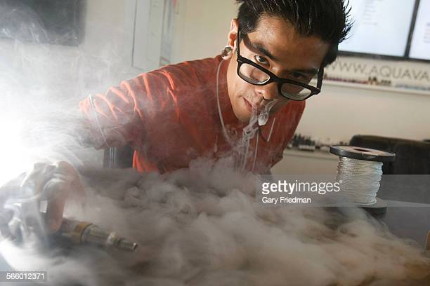 Aaron Flores exhales water vapors from an electronic cigarette at Aqua Vape on August 29 2013 in Temple City In August Temple City passed a new...