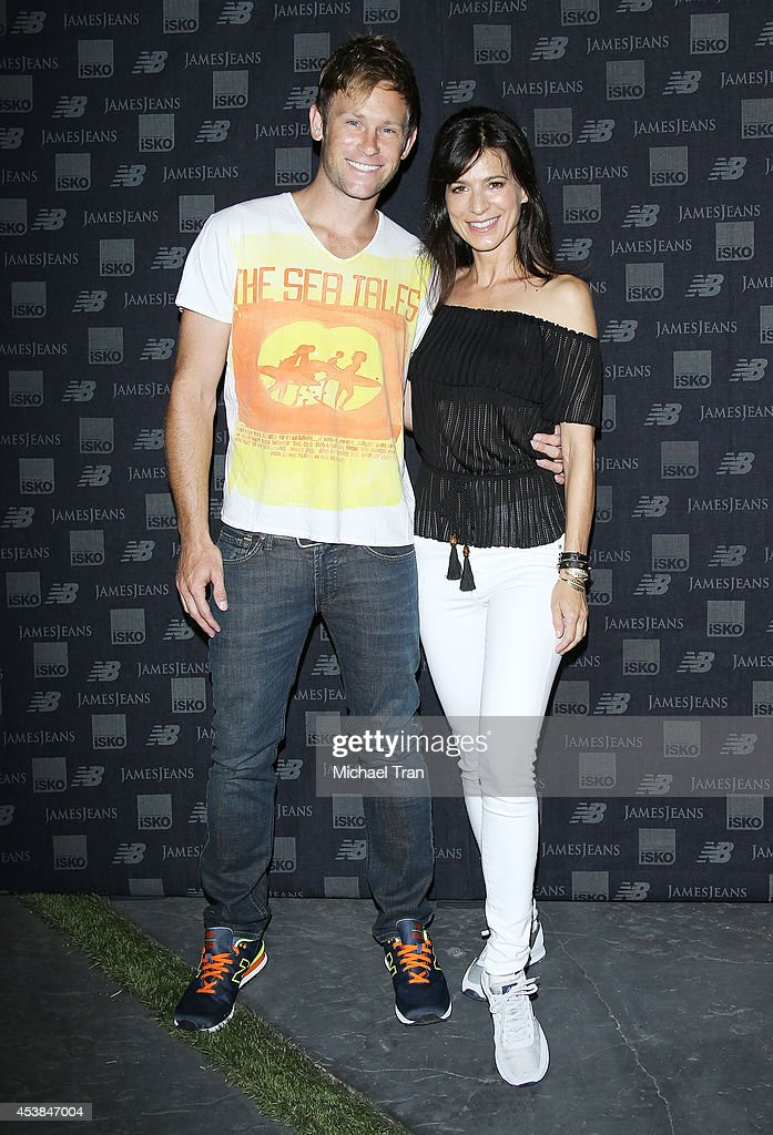 Aaron Fox (L) and Perrey Reeves arrive at the dance party with New Balance and James Jeans powered by ISKO held at a private residence on August 19, 2014 in Beverly Hills, California.
