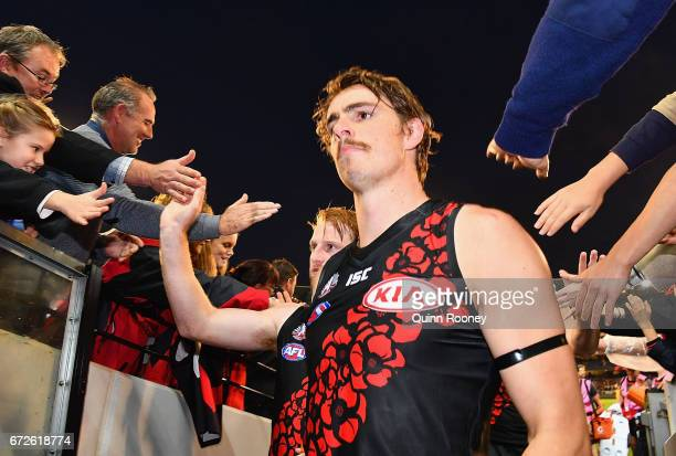 Aaron Francis and Joe Daniher of the Bombers high fives fans after winning the round five AFL match between the Essendon Bombers and the Collingwood...