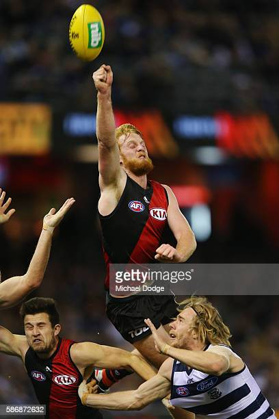 Aaron Francis competes for the ball over Cameron Guthrie of the Cats of the Bombers during the round 20 AFL match between the Geelong Cats and the...