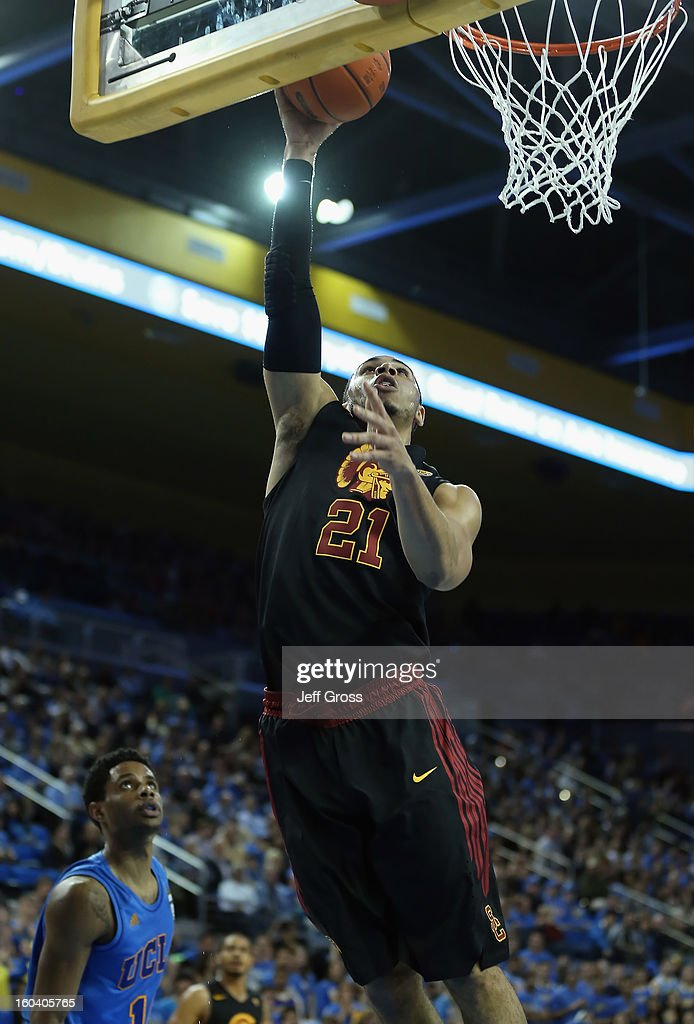 Aaron Fuller #21 of the USC Trojans goes up for a layup in the first half against the UCLA Bruins at Pauley Pavilion on January 30, 2013 in Los Angeles, California.