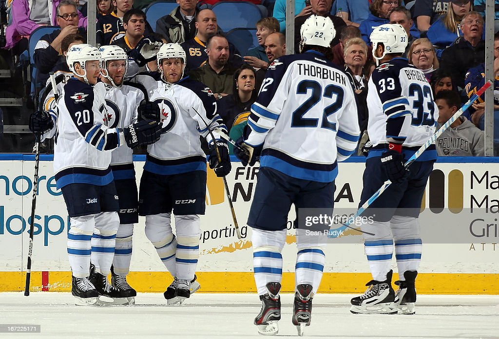 Aaron Gagnon #21 of the Winnipeg Jets celebrates his second period goal against the Buffalo Sabres with teammates Antti Miettinen #20, Derek Meech #7, Chris Thorburn #22 and Dustin Byfuglien #33 at First Niagara Center on April 22, 2013 in Buffalo, New York.