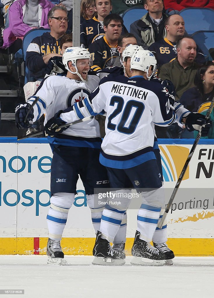 Aaron Gagnon #21 of the Winnipeg Jets celebrates his second period goal against the Buffalo Sabres with teammates Antti Miettinen #20 and Derek Meech #7 at First Niagara Center on April 22, 2013 in Buffalo, New York. Winnipeg defeated Buffalo, 2-1.
