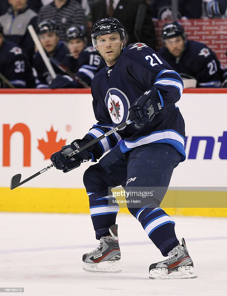 Aaron Gagnon #21 of the Winnipeg Jets skates in second-period action against the Buffalo Sabres on April 9, 2013 at the MTS Centre in Winnipeg, Manitoba, Canada. Gagnon scored his first career NHL goal in the game.
