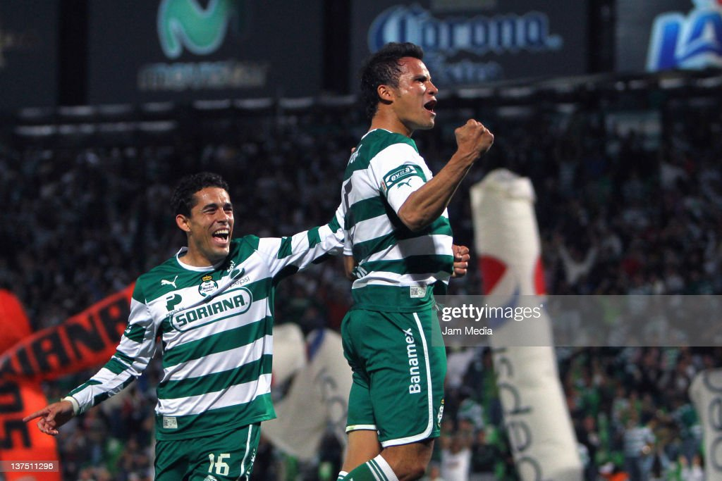 <a gi-track='captionPersonalityLinkClicked' href=/galleries/search?phrase=Aaron+Galindo&family=editorial&specificpeople=771464 ng-click='$event.stopPropagation()'>Aaron Galindo</a> (R) of Santos celebrates with teammates a scored goal against Jaguares during a match between Santos v Jaguares at the Clausura Tournament 2012 at Corona Stadium on January 21, 2012 in Torreon, Mexico.