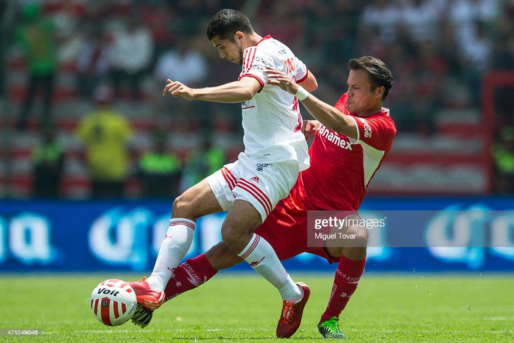 Aaron Galindo of Toluca fights for the ball with <a gi-track='captionPersonalityLinkClicked' href=/galleries/search?phrase=Joe+Corona&family=editorial&specificpeople=8282654 ng-click='$event.stopPropagation()'>Joe Corona</a> of Tijuana during a match between Toluca and Tijuana as part of 15th round Clausura 2015 Liga MX at Nemesio Diez Stadium on April 26, 2015 in Toluca, Mexico.