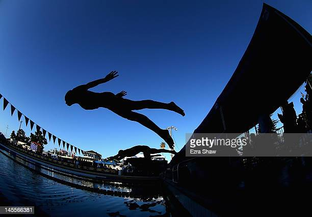 Aaron Ghiglieri dives in for the start of the C Final in the men's 100 meter butterfly during day 2 of the Santa Clara International Grand Prix at...
