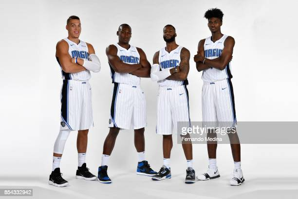 Aaron Gordon Bismack Biyombo Jonathon Simmons and Jonathan Isaac of the Orlando Magic pose for a portrait during NBA Media Day on September 25 2017...