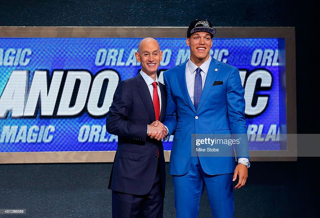 Aaron Gordon of Arizona (R) shakes hands with NBA Commissioner Adam Silver after being selected with the #4 overall pick by the Orlando Magic during the 2014 NBA Draft at Barclays Center on June 26, 2014 in the Brooklyn borough of New York City.