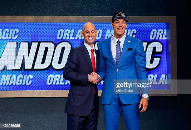 Aaron Gordon of Arizona shakes hands with NBA Commissioner Adam Silver after being selected with the overall pick by the Orlando Magic during the...