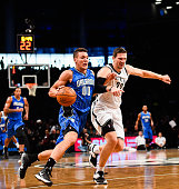Aaron Gordon of the Orlando Magic attempts to dribble past Mirza Teletovic of the Brooklyn Nets in the first half at the Barclays Center on November...