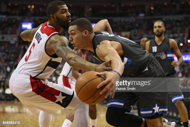 Aaron Gordon of the Orlando Magic dribbles past Markieff Morris of the Washington Wizards during the first half at Verizon Center on March 5 2017 in...
