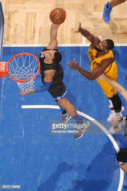 Aaron Gordon of the Orlando Magic dunks against Tristan Thompson of the Cleveland Cavaliers during the game on March 11 2017 at Amway Center in...