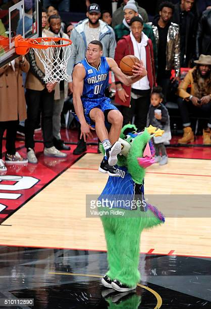 Aaron Gordon of the Orlando Magic dunks over Stuff the Orlando Magic mascot in the Verizon Slam Dunk Contest during NBA AllStar Weekend 2016 at Air...