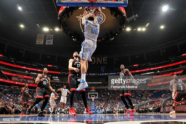 Aaron Gordon of the Orlando Magic dunks the ball during the game against the Toronto Raptors on December 18 2016 at Amway Center in Orlando Florida...