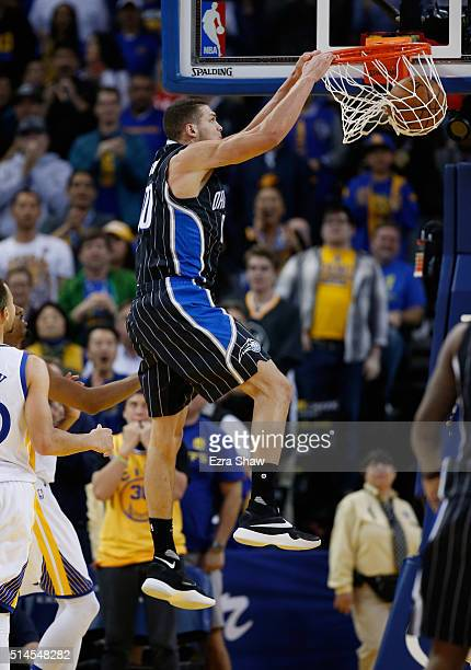 Aaron Gordon of the Orlando Magic goes up for a dunk against the Golden State Warriors at ORACLE Arena on March 7 2016 in Oakland California NOTE TO...