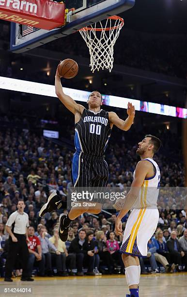 Aaron Gordon of the Orlando Magic goes up for a dunk on Andrew Bogut of the Golden State Warriors at ORACLE Arena on March 7 2016 in Oakland...