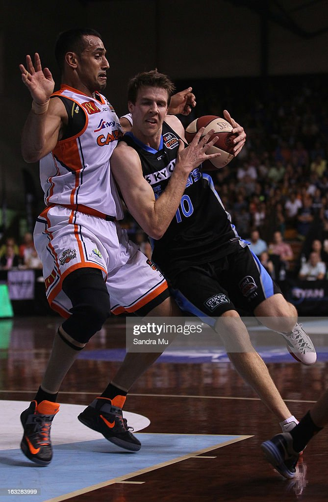 Aaron Grabau of the Titans (L) and Tom Abercrombie of the Breakers in action during the round 22 NBL match between the New Zealand Breakers and the Cairns Taipans at North Shore Events Centre on March 7, 2013 in Auckland, New Zealand.
