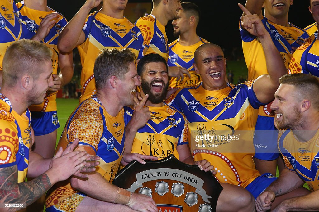 Aaron Gray, Chris Lawrence, Josh Mansour, Leilani Latu and Bryce Cartwright of City celebrate with the shield after victory during the NSW Origin match between City and Country at Scully Park on May 8, 2016 in Tamworth, Australia.