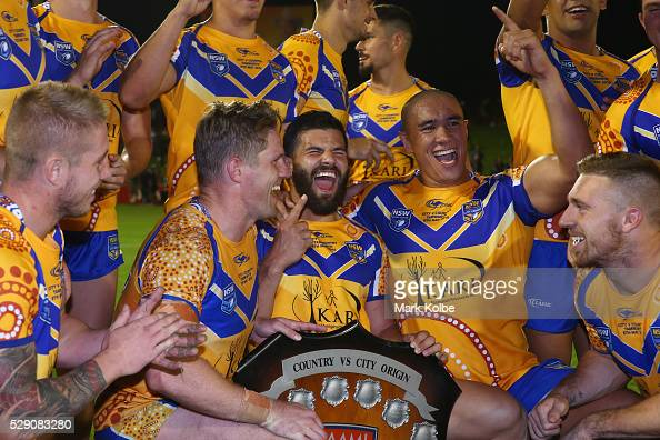 Aaron Gray Chris Lawrence Josh Mansour Leilani Latu and Bryce Cartwright of City celebrate with the shield after victory during the NSW Origin match...