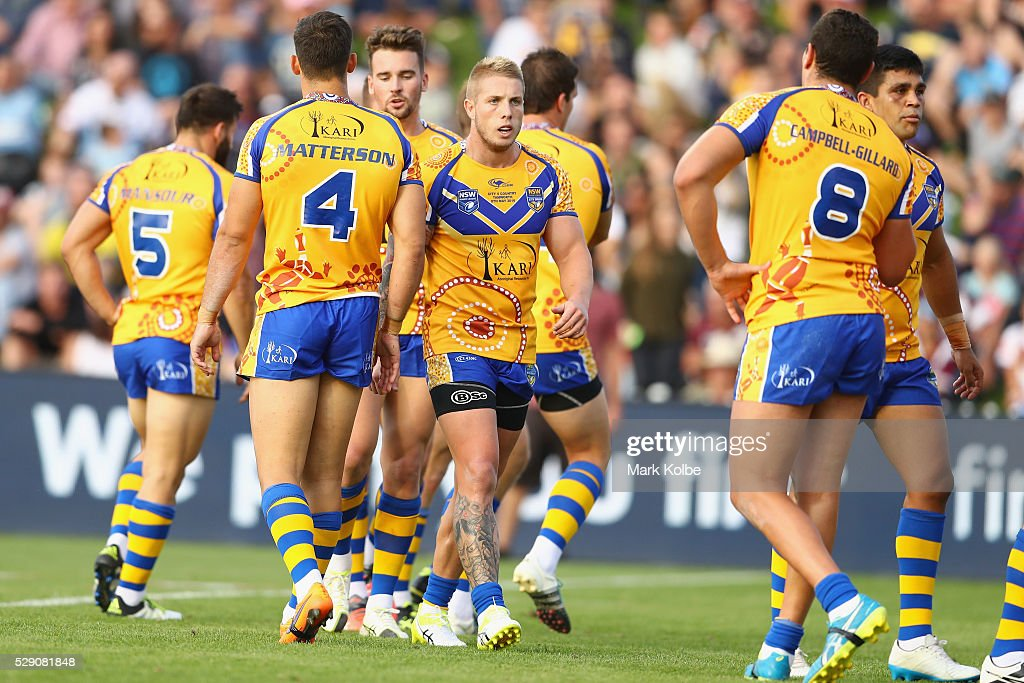 Aaron Gray of City celebrates with his team mates after scoring a try during the NSW Origin match between City and Country at Scully Park on May 8...