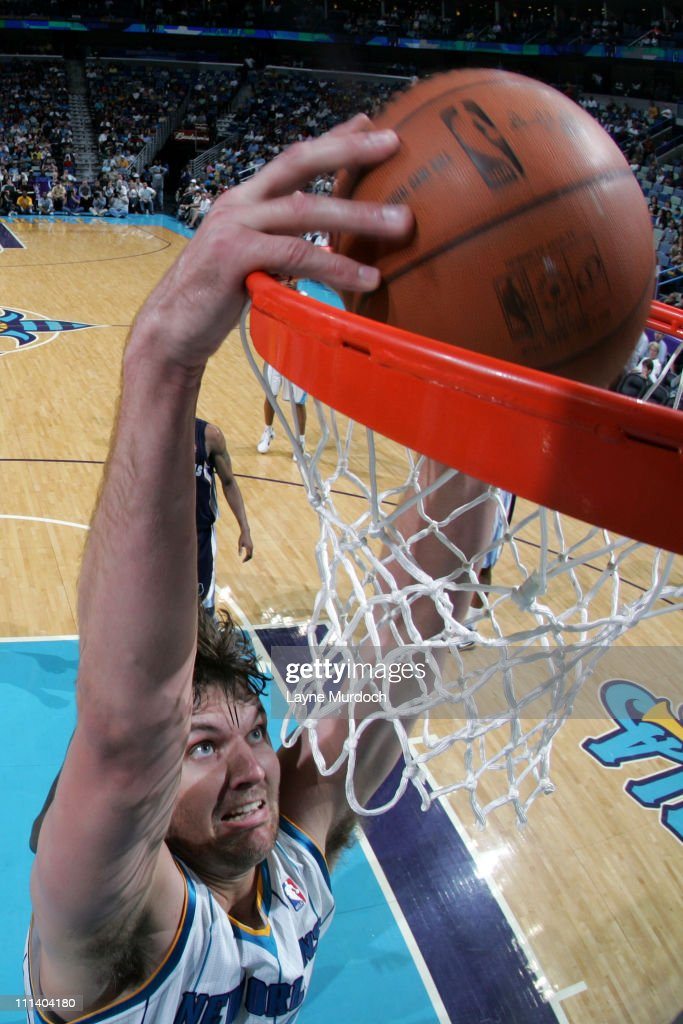 Aaron Gray of the New Orleans Hornets dunks against the Memphis Grizzlies during the game on April 1 2011 at the New Orleans Arena in New Orleans...
