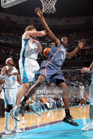 Aaron Gray of the New Orleans Hornets fouls Nazr Mohammed of the Charlotte Bobcats as he goes up for a shot on April 7 2010 at the New Orleans Arena...