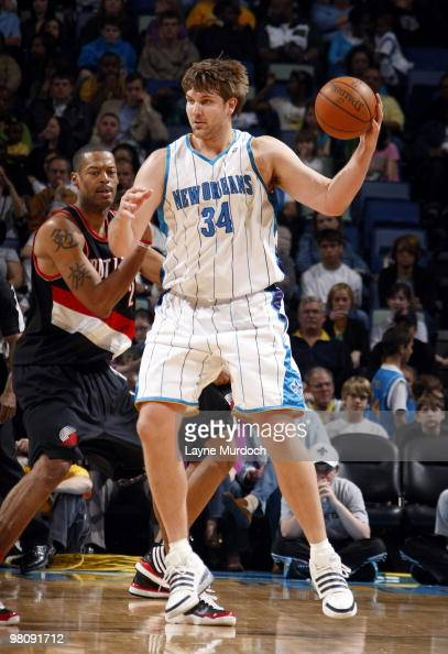 Aaron Gray of the New Orleans Hornets looks to pass against Marcus Camby of the Portland Trail Blazers on March 27 2010 at the New Orleans Arena in...